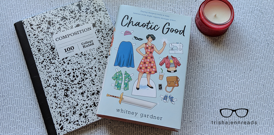Chaotic Good book with a notebook and candle on trishajennreads.com