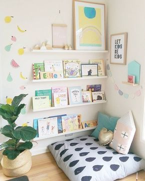 Reading corner with shelves of books and a pillow to sit on.