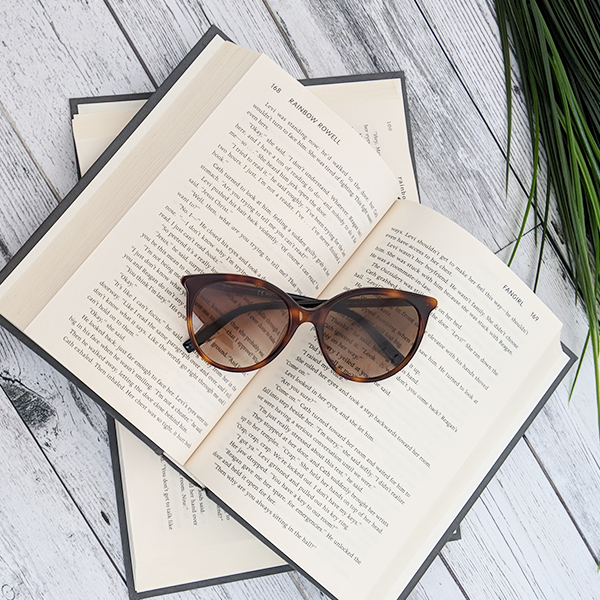 Sunglasses and books.