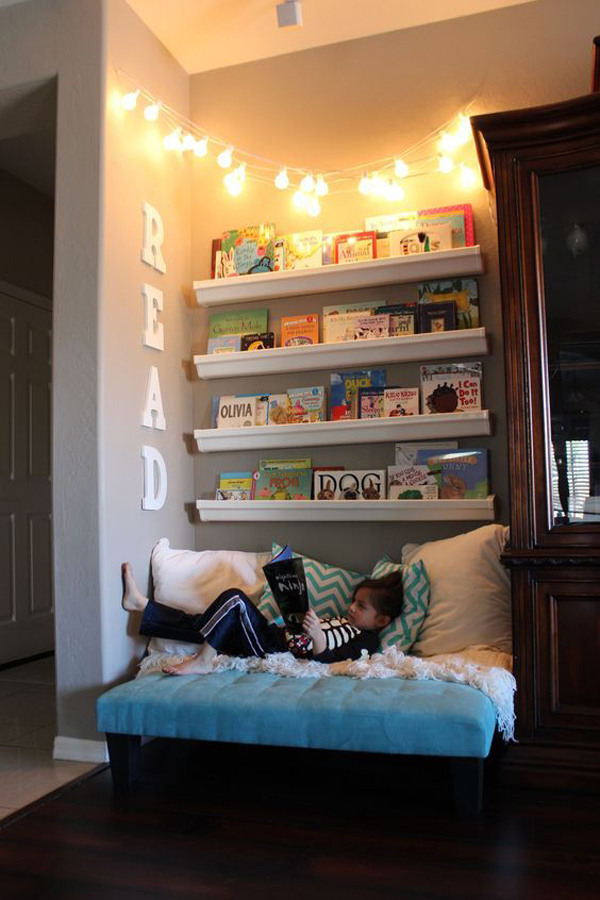 reading nook with shelves and fairy lights