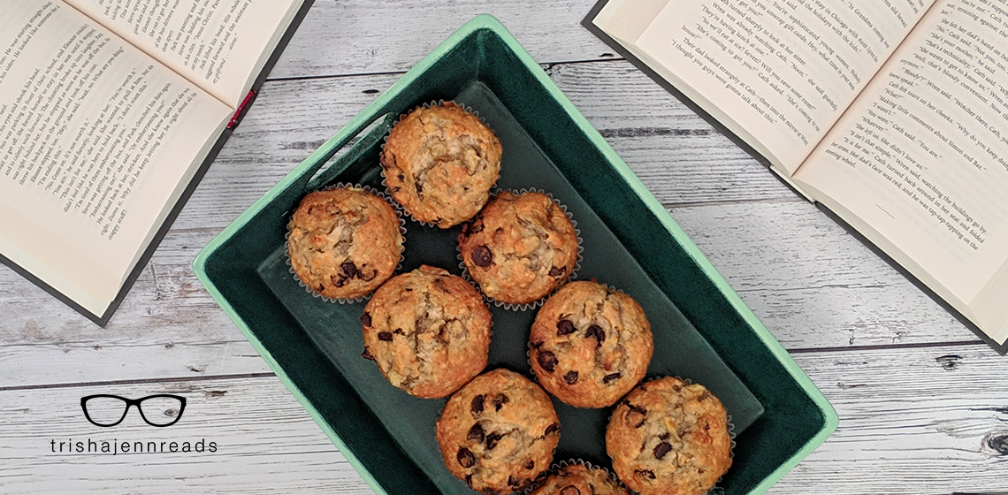 a tray of muffins with two open books