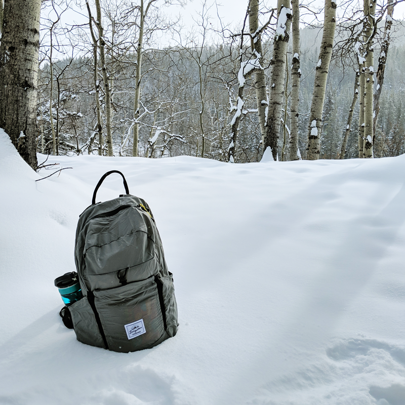 a grey backpack in snow