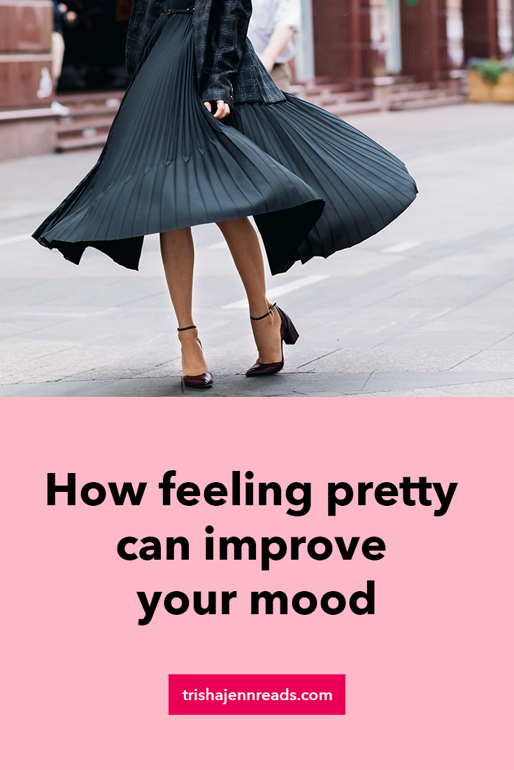 A woman twirling in a black dress | How feeling pretty can improve your mood on trishajennreads.com