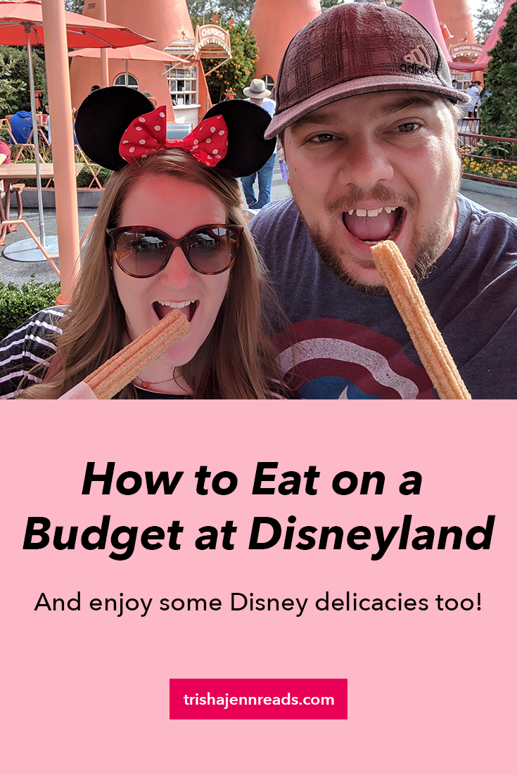 How to eat on a budget at Disneyland - and enjoy some disney delicacies too - on trishajennreads.com - photo of a man and a woman eating churros at Disneyland