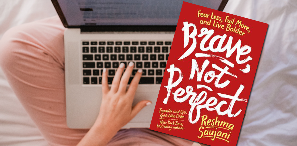 [image] Cover of Brave, Not Perfect book (red) above an open laptop with a hand typing