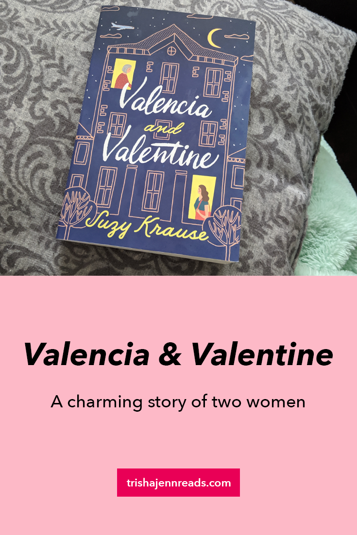 [text] Valencia and Valentine, a charming story of two women [image] purple book resting on a grey throw pillow