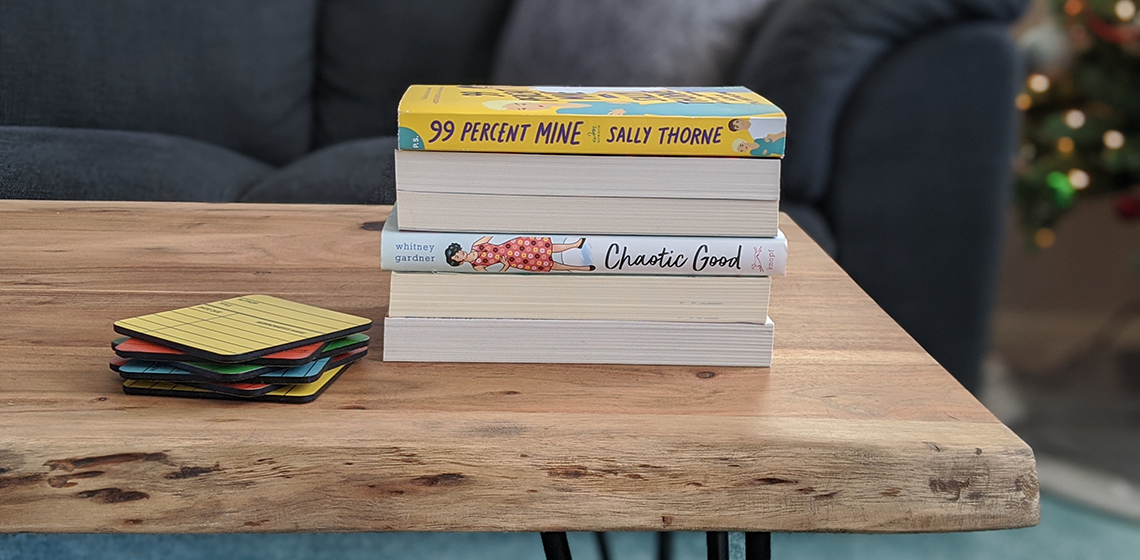 a stack of books on a coffee table