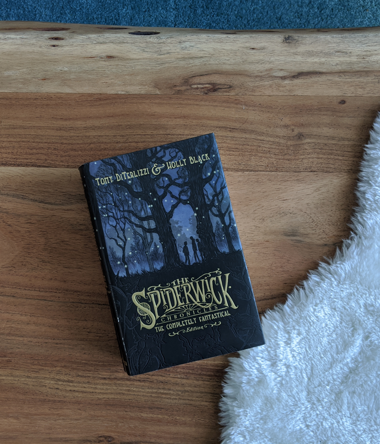The Spiderwick Chronicles in one volume on a wood coffee table