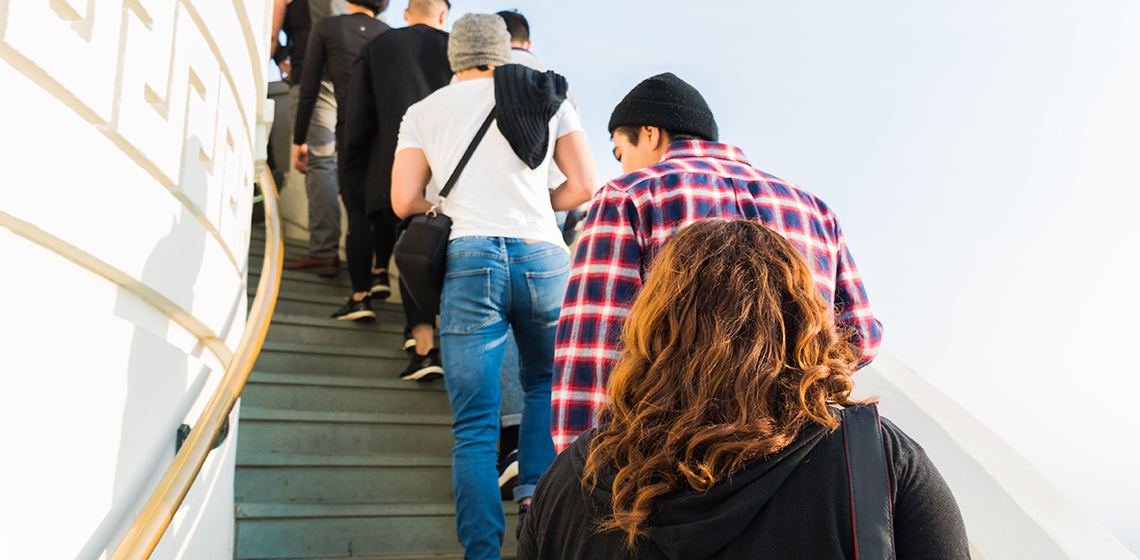 People standing in line on stairs